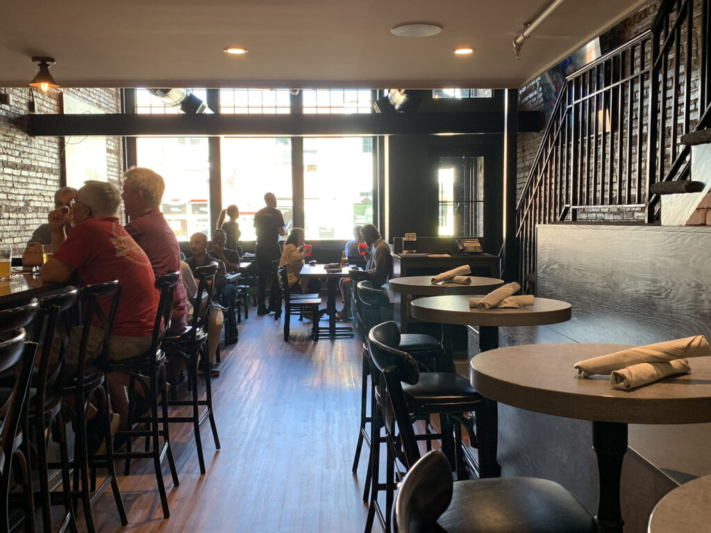 Interior of KC's Alley Restaurant with guests dinning